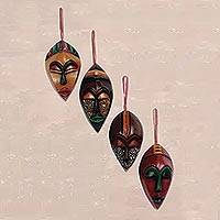 Wood ornaments, 'Celebration Masks' (set of 4) - Set of 4 Ornamental Sese Wood African Masks