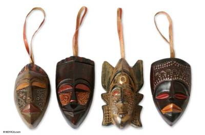 Wood ornaments, 'Festive Masks' (set of 4) - Artisan Crafted Wood Christmas Ornaments (Set of 4)