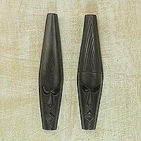Ashanti wood masks, 'Fighting Spirit' (pair)