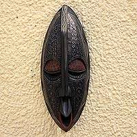 African wood mask, 'Family First'
