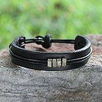 Men's leather wristband bracelet, 'Stand Together in Black' - Hand Crafted Fair Trade Men's Leather Wristband Bracelet