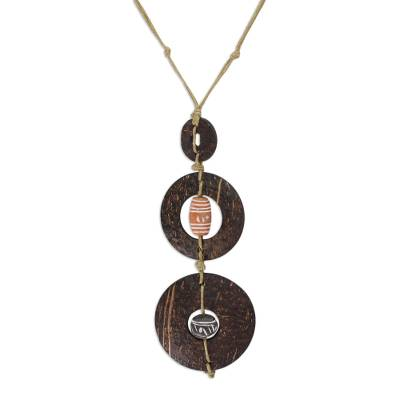 Coconut shell necklace, 'Bold Africa' - Coconut Shell Pendant Necklace
