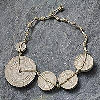 Recycled paper pendant necklace, 'Knotted Sideways' - Recycled paper pendant necklace