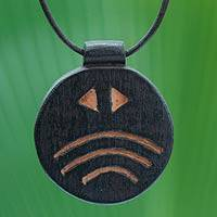 Men's teakwood pendant necklace, 'Onyame Aniwa' - Men's Wood Pendant Necklace