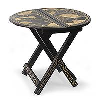 Wood accent table, 'Ahoto II' - Handcrafted African Animal Themed Wood Folding Table