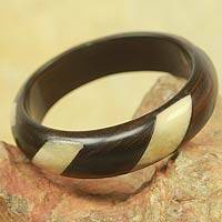 Ebony wood and bone bangle bracelet, 'Naabpua' - Handcrafted Ebony Wood and Bone Bangle Bracelet