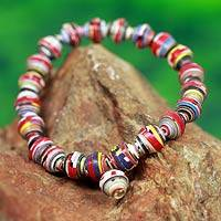 Recycled paper stretch bracelet, 'Love Affair' - Handmade Bracelet with Multicolor Recycled Paper Beads