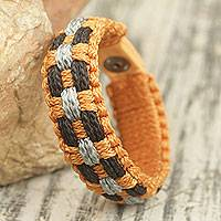 Men's wristband bracelet, 'Perseverance' - Artisan Crafted Men's Bracelet with Orange and Gray Cords