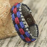 Men's wristband bracelet, 'Excellence' - Multicolored Woven Cord Wristband Bracelet for Men