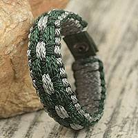 Men's wristband bracelet, 'Inner Fortitude' - Dark Green and Gray Hand Woven Men's Cord Bracelet