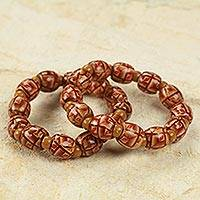 Wood stretch bracelets, 'Have Faith' (pair) - Ghana Hand Crafted Wood Stretch Bracelets (Pair)