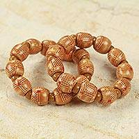 Wood stretch bracelets, 'Twice Happy' (pair) - 2 Fair trade African Beaded Wood Stretch Bracelets