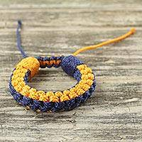 Men's wristband bracelet, 'Awindazi Golden Blue' - Men's Hand Woven Wristband Bracelet in Blue and Gold