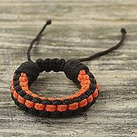 Men's wristband bracelet, 'Earth Mover' - Ghanaian Hand Braided Orange and Black Men's Bracelet