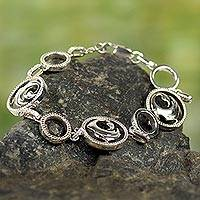 Sterling silver link bracelet, 'Learn from the Past' - Sterling Silver and Zirconia African Adinkra Symbol Bracelet
