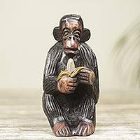 Ebony wood figurine, 'Monkey Peeling a Banana' - Hand Carved Animal Theme Figurine African Ebony Sculpture