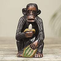 Ebony wood figurine, 'Banana Snack' - Hand Carved Monkey Theme African Ebony Sculpture