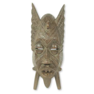 African Wood Mask with Fangs and Fins from Ghana