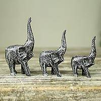 Wood sculptures, 'Cheerful Black Elephants' (set of 3) - Set of 3 Hand Carved Wood African Elephant Sculptures