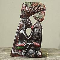 Wood wall sculpture, 'Mango Eater' - African Wall Sculpture Hand Carved of Wood in Ghana