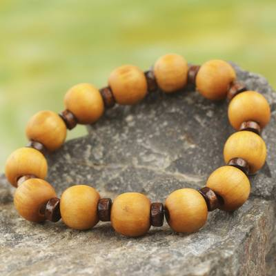 Wood stretch bracelet, 'Labadi Warmth' - Handcrafted Stretch Bracelet with Wood Beads