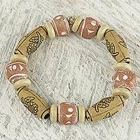 Wood and recycled plastic beaded bracelet, 'Desert Breeze' - Hand Crafted Stretch Bracelet with Floral Motif from Ghana
