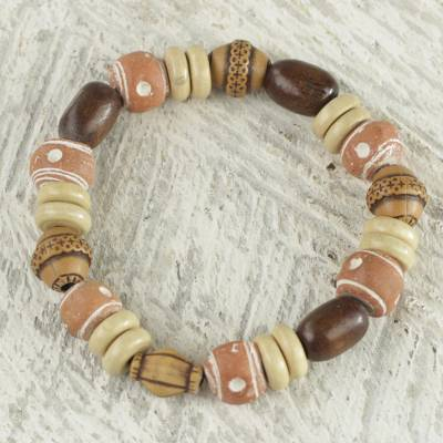 Wood beaded stretch bracelet, 'Strong' - Recycled Plastic Sese Wood Beaded Stretch Bracelet