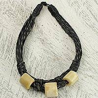 Leather and bone torsade necklace, 'Yembo Black' - Leather Artisan Crafted Torsade Necklace with Bone Squares