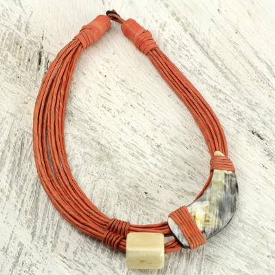 Leather and horn torsade necklace, 'Sougri Orange' - Horn and Bone Pendants on Recycled Beads Orange Necklace