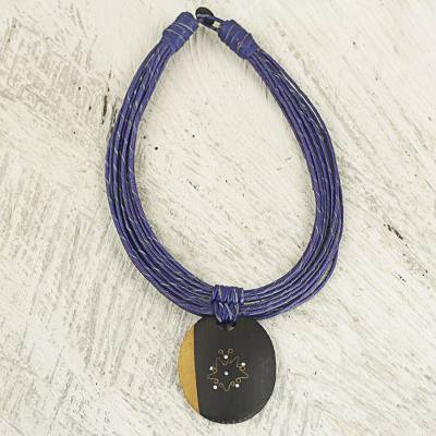 Ebony wood pendant necklace, 'Zacksongo in Blue' - Ebony Wood Pendant Necklace with Blue Leather Cord