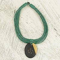 Ebony wood pendant necklace, 'Zacksongo in Green' - Ebony Wood Pendant Necklace with Green Leather Cord