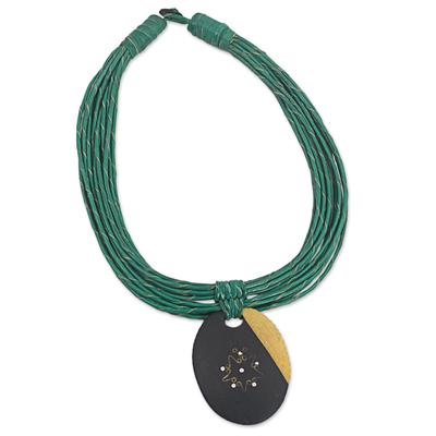 Ebony wood pendant necklace, 'Zacksongo in Green' - Ebony Wood Pendant Necklace with Green Leather Cord