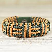 Cord bracelet, 'Green and Gold Kente Power' - Gold and Green Cord Striped Bracelet Handmade in Ghana