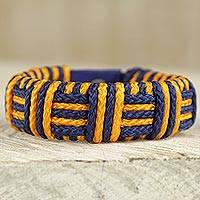 Cord bracelet, 'Blue and Gold Kente Power' - Blue and Gold Cord Striped Bracelet Handmade in Ghana