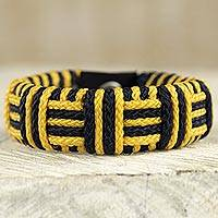 Cord bracelet, 'Yellow and Black Kente Power' - Yellow and Black Cord Striped Bracelet Handmade in Ghana