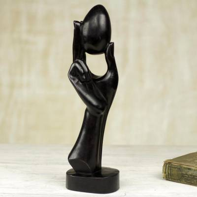 Hand Carved Wooden Sculpture of Hand Holding Egg, 'Authority is Like an Egg'