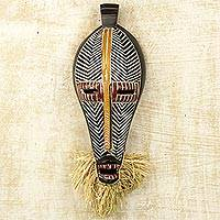 African wood mask, 'Monifa' - Hand Carved Ghanaian Sese Wood Wall Mask with Raffia
