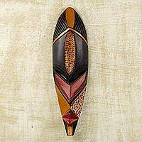 African wood mask, 'Akpe Gratitude' - Hand Crafted Sese Wood African Wall Mask in Black and Orange