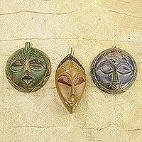 African wood masks, 'Sefam' (set of 3) - Set of 3 Petite Handcrafted Sese Wood African Masks