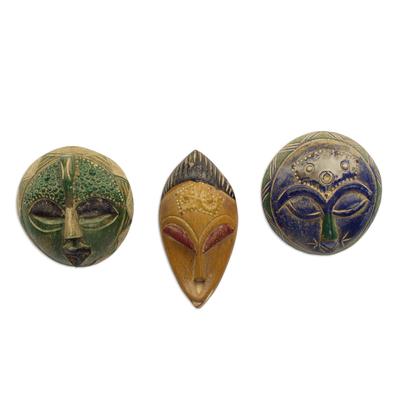African wood masks, 'Sefam' (set of 3) - Set of 3 Petite Handcrafted Sese Wood African Masks