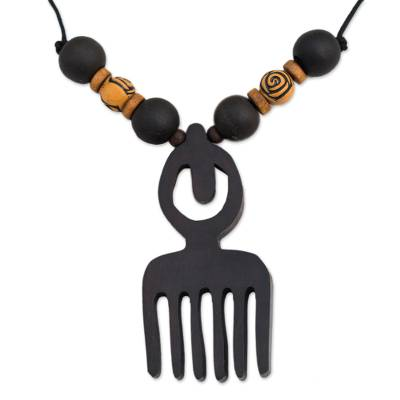 Wood pendant necklace, 'Duafe Comb' - Artisan Crafted Adinkra Wood Necklace with Duafe Comb Symbol