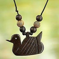 Wood pendant necklace, 'Serene Duck' - Artisan Crafted Serene Duck Wood Pendant Necklace from Ghana