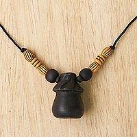 Wood pendant necklace, 'Village Hut' - Sese Wood Adjustable Pendant Necklace from Ghana