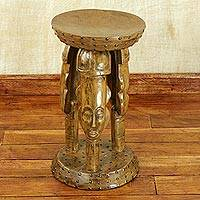 Cedar wood stool, 'United Family in Tan' - Hand Crafted Cedar Wood Faces Stool from Ghana