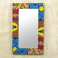 Wood and cotton wall mirror, 'Asasaawa' - Wall Mirror with Brightly Printed Fabric Frame from Ghana