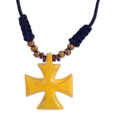 Wood pendant necklace, 'Cross of Divinity' - Adjustable Sese Wood Yellow Cross Necklace from Ghana