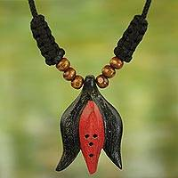 Wood pendant necklace, 'Oson Style' - Ethnic Style Abstract Elephant Hand Carved Wood Necklace