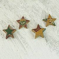 Wood ornaments, 'Nsruma Glory' (set of 4) - Four Sese Wood Star Ornaments in Red Green and Yellow