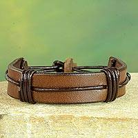 Men's leather wristband bracelet, 'Enduring Strength in Brown' - Men's Brown Leather Wristband Bracelet from Ghana