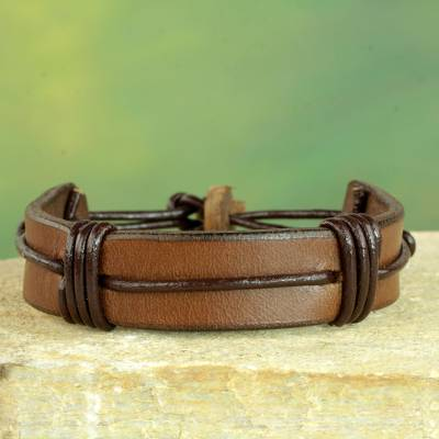 Men's leather wristband bracelet, 'Enduring Strength in Brown' - Men's Brown Leather Wristband Bracelet from Ghana